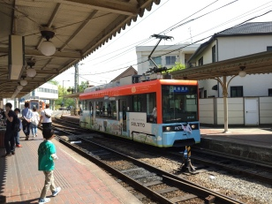 The Matsuyama tram (new version). The old style is visible in the background. The tram system in extremely convenient, easy to use, affordable, and fun.
